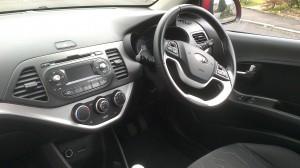 The interior and dashboard of the Kia Picanto City